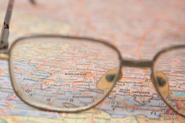 close-up 的 glasses on map
